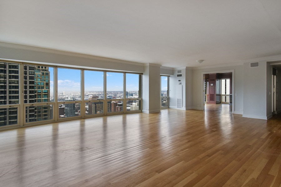 Real Estate Photography - 100 E Huron, 3701, Chicago, IL, 60601 - Living Room/Dining Room