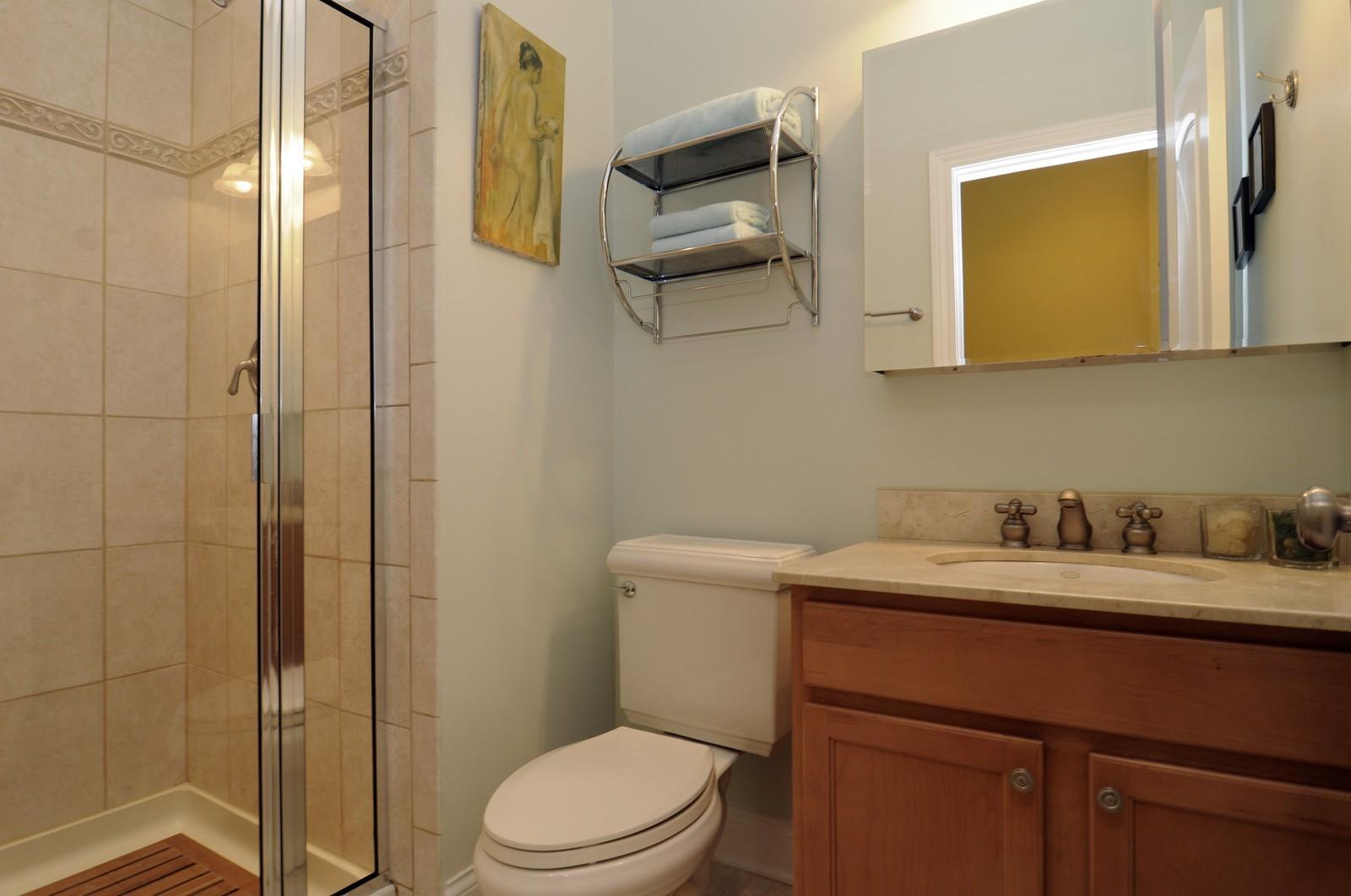 Real Estate Photography - 1514 W Victoria, Unit 1, Chicago, IL, 60660 - Second Bath
