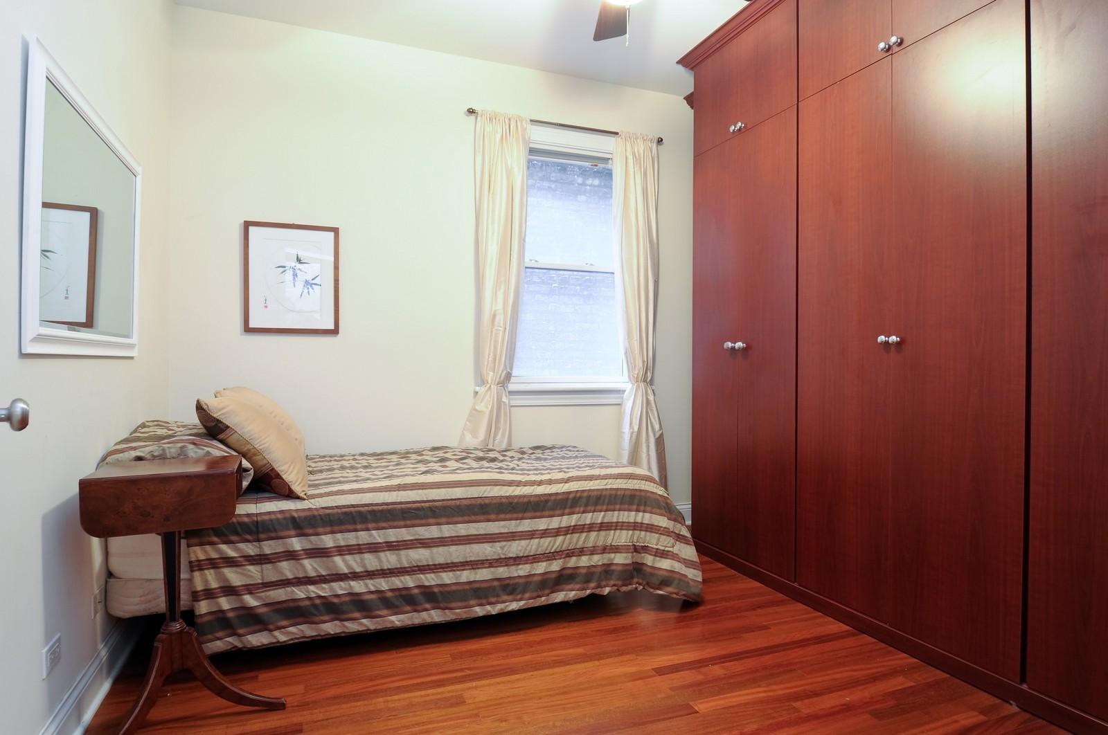 Real Estate Photography - 1514 W Victoria, Unit 1, Chicago, IL, 60660 - Second Bedroom