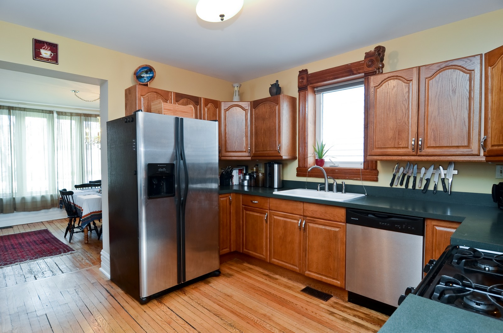 Real Estate Photography - 3525 W Wollfram, Chicago, IL, 60618 - Kitchen / Dining Room