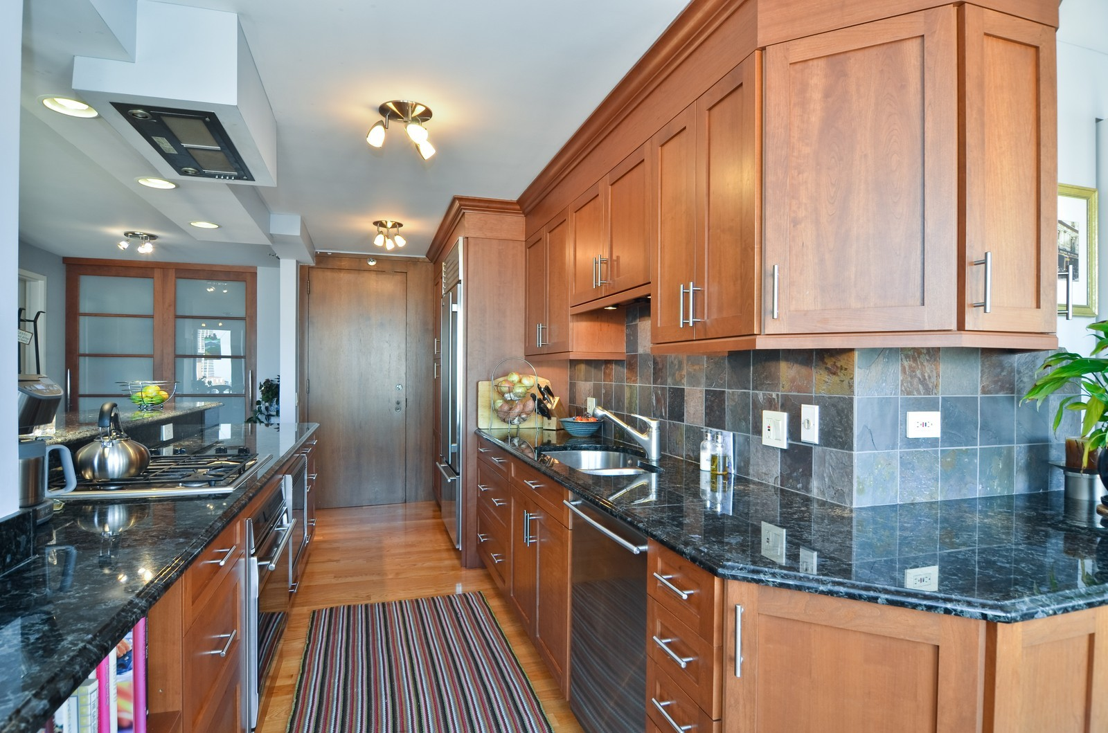 Real Estate Photography - 1230 N. State Parkway, Unit 26BC, Chicago, IL, 60610 - Updated kitchen with wrap around counter