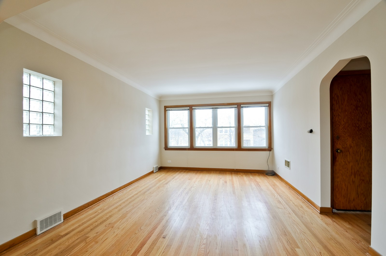 Real Estate Photography - 5457 W Schubert, Unit 1, Chicago, IL, 60639 - Living Room