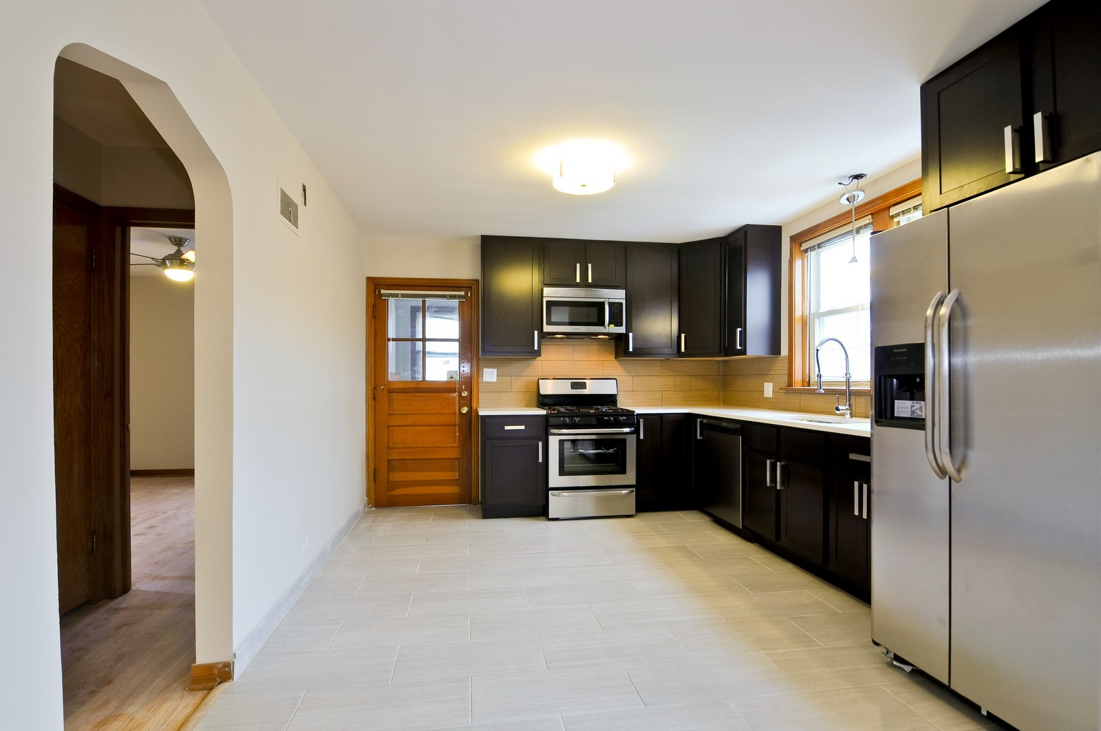 Real Estate Photography - 5457 W Schubert, Unit 1, Chicago, IL, 60639 - Kitchen
