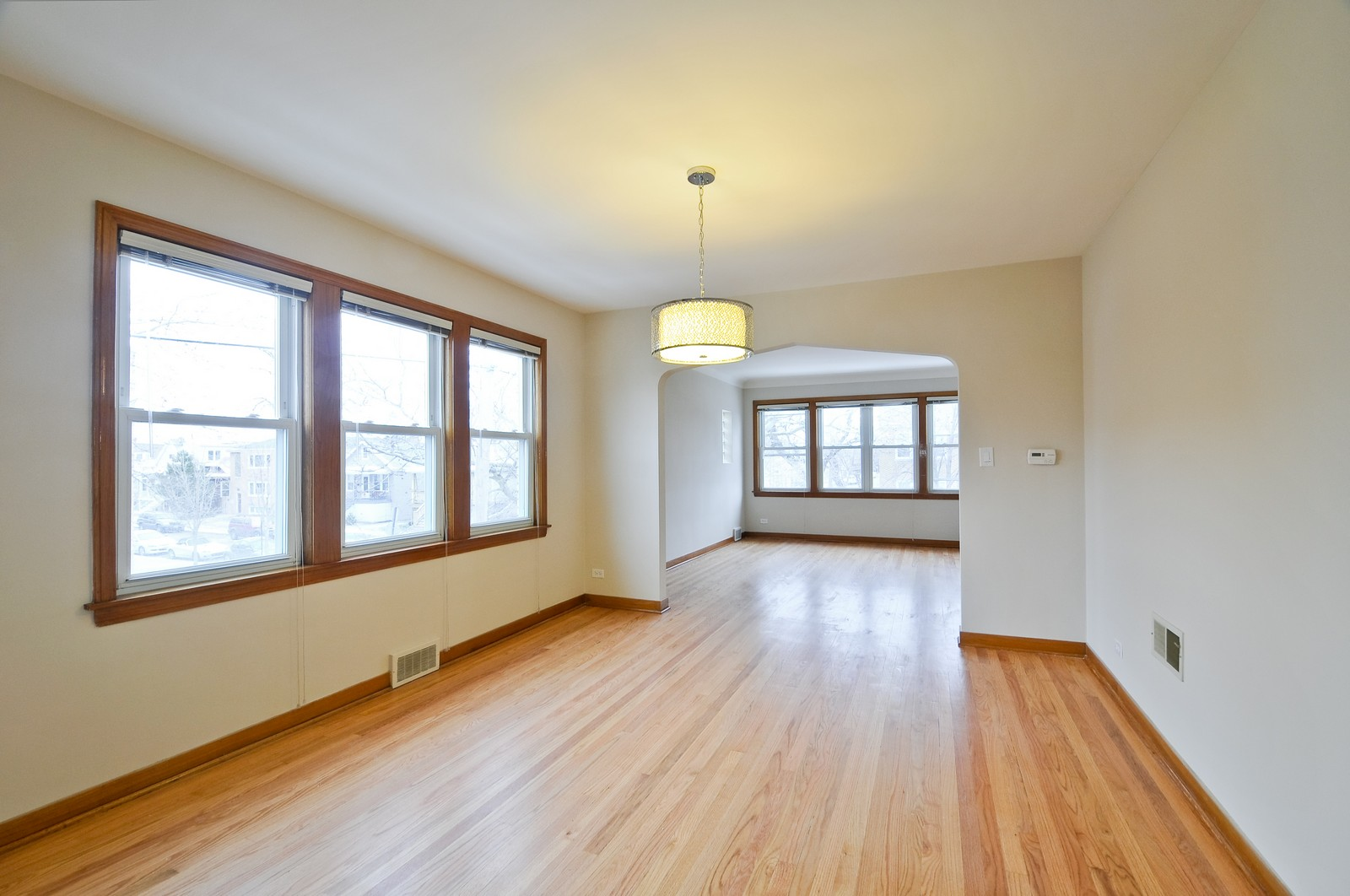 Real Estate Photography - 5457 W Schubert, Unit 1, Chicago, IL, 60639 - Living Room / Dining Room
