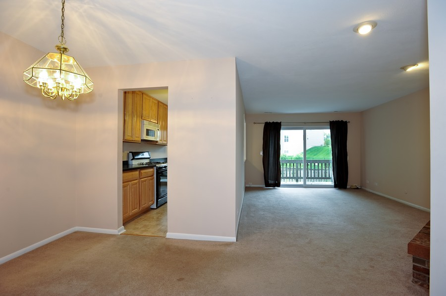 Real Estate Photography - 29W431 Emerald Green, Unit F, Warrenville, IL, 60555 - Kitchen / Living Room