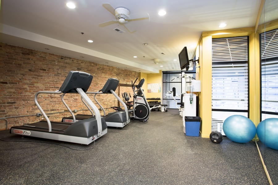 Real Estate Photography - 616 W Fulton, Unit 609, Chicago, IL, 60661 - Fitness Room