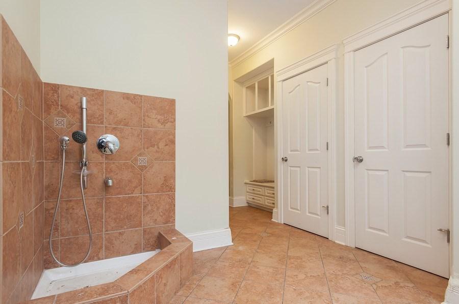 Real Estate Photography - 815 Happ Rd, Northfield, IL, 60093 - mudroom with dog bath