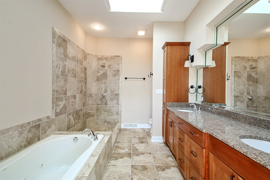 Real Estate Photography - 1460 Geneva Club Drive, Lake Geneva, WI, 53147 - Master bath with getted tub and beautiful cabinetr