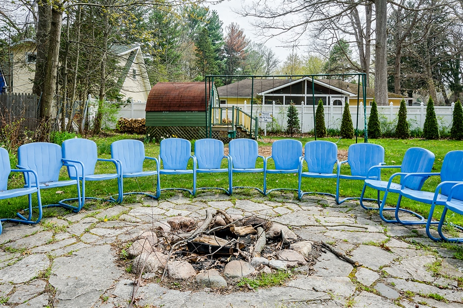 Real Estate Photography - 15657 Lake Shore Rd, #17, Union Pier, MI, 49129 - Fire pit and grilling area