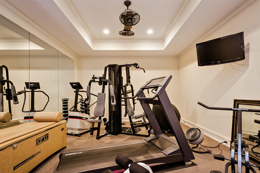 Real Estate Photography - 5750 Dunham Path, Stevensville, MI, 49127 - Exercise Room