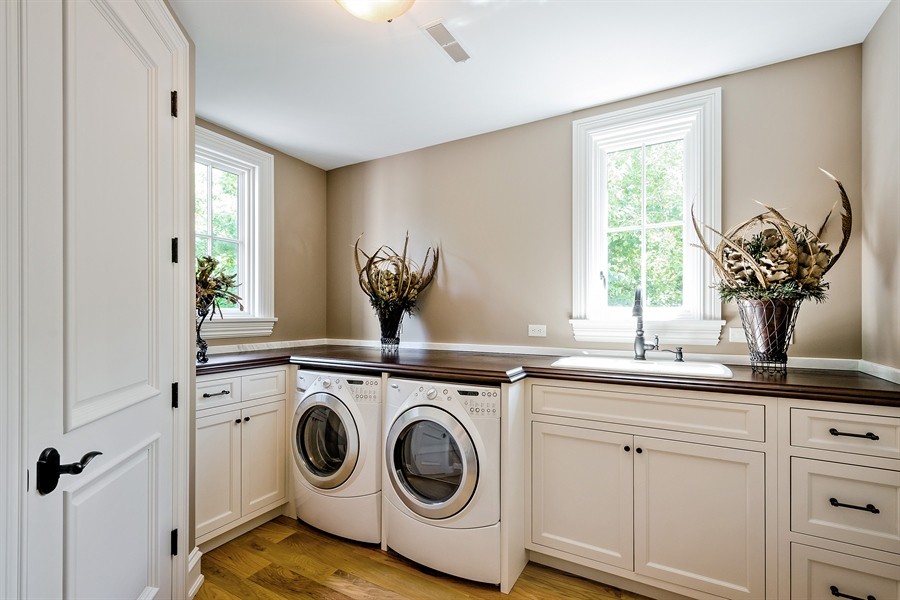 Real Estate Photography - 5750 Dunham Path, Stevensville, MI, 49127 - Upper Level Laundry