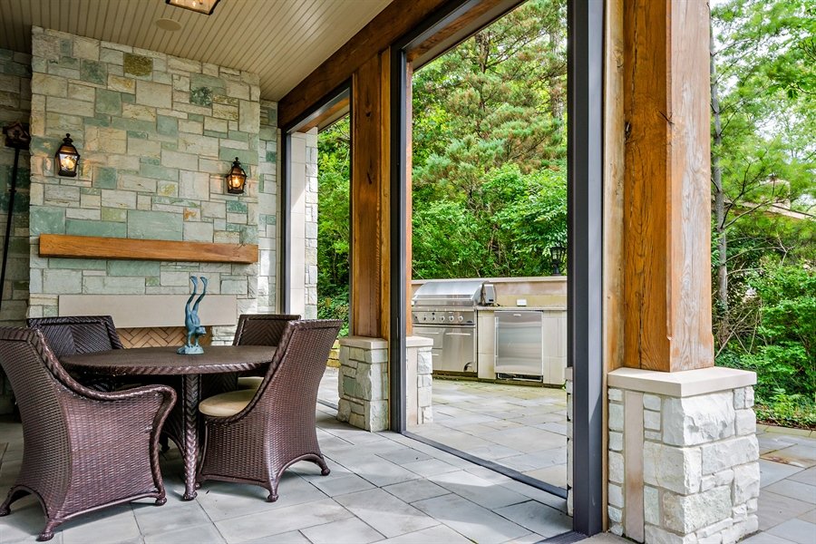 Real Estate Photography - 5750 Dunham Path, Stevensville, MI, 49127 - Screened Porch and Outdoor Kitchen
