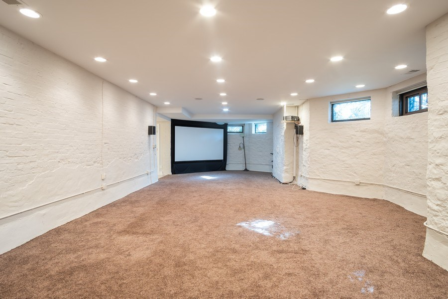 Real Estate Photography - 1036 N Hoyne Ave, Chicago, IL, 60622 - Lower Level Family Room
