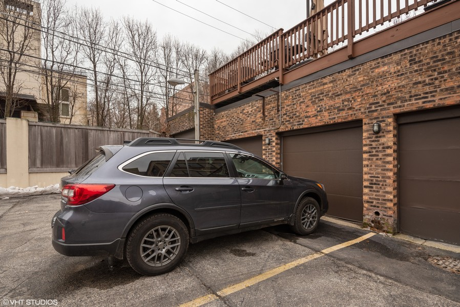 Real Estate Photography - 1855 N Halsted St, 4, Chicago, IL, 60614 - Garage Parking and Exterior Parking Space
