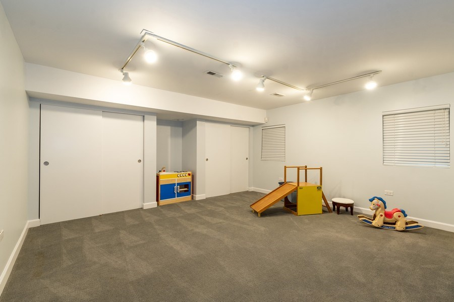 Real Estate Photography - 1930 Phillips, Northbrook, IL, 60062 - Play room (basement)