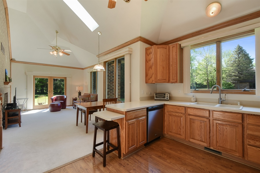 Real Estate Photography - 27948 W Kelsey Rd, Lake Barrington, IL, 60010 - Guest House Kitchen / Living Room