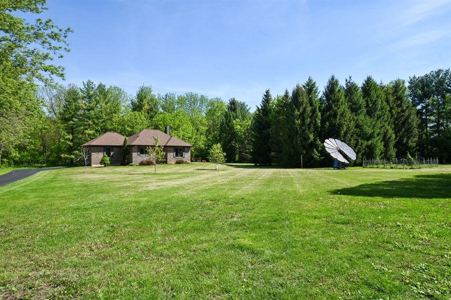 Real Estate Photography - 27948 W Kelsey Rd, Lake Barrington, IL, 60010 - Back Yard wWith Guest House View