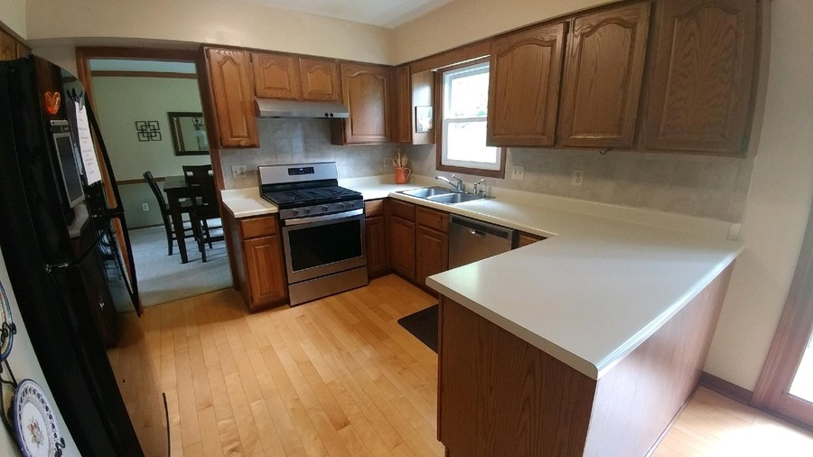Real Estate Photography - 910 Manley, St Charles, IL, 60174 - Kitchen with new stainless range and dishwasher, b
