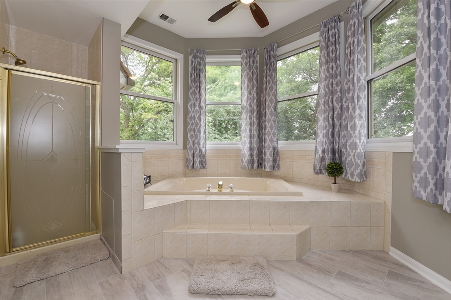 Real Estate Photography - 1587 Far Hills Dr, Bartlett, IL, 60103 - Tranquil Spa Like Bathroom with Lake Views