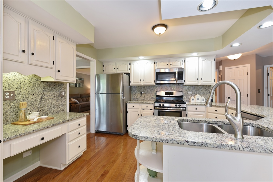 Real Estate Photography - 1587 Far Hills Dr, Bartlett, IL, 60103 - Updated Kitchen with Granite, SS and Desk Area