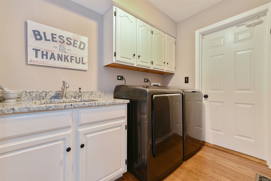 Real Estate Photography - 1587 Far Hills Dr, Bartlett, IL, 60103 - 1st Floor Mudroom and Laundry Access
