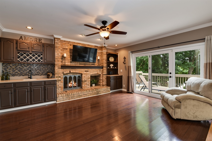 Real Estate Photography - 1587 Far Hills Dr, Bartlett, IL, 60103 - Family Room with Outdoor Access