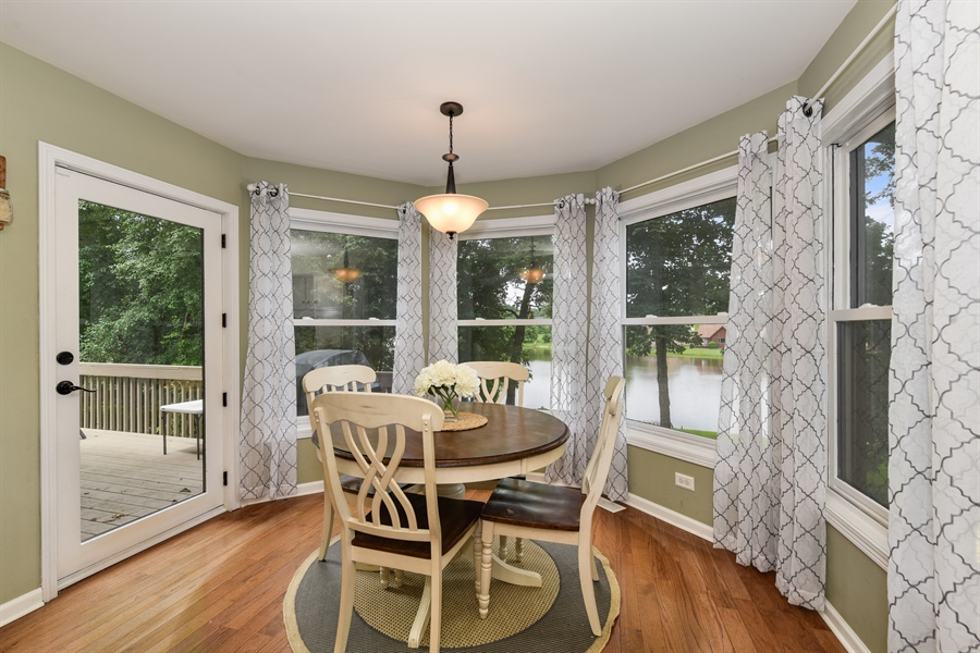 Real Estate Photography - 1587 Far Hills Dr, Bartlett, IL, 60103 - Eat-In Kitchen with Spectacular Lake Views