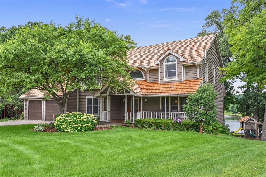 Real Estate Photography - 1587 Far Hills Dr, Bartlett, IL, 60103 - Oversized Porch and Professional Landscaping