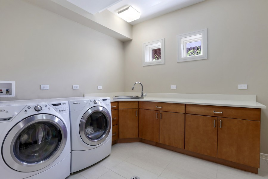 Real Estate Photography - 1544 West Henderson Street, Chicago, IL, 60657 - Lower Level Laundry Room
