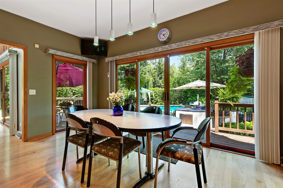 Real Estate Photography - 2035 Wagner Rd, Glenview, IL, 60025 - Breakfast area with pool view