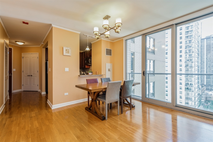 Real Estate Photography - 420 E Waterside Dr, Unit 1104, Chicago, IL, 60601 - Dining Room
