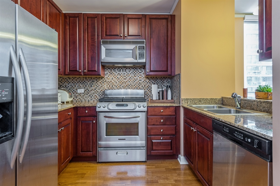 Real Estate Photography - 420 E Waterside Dr, Unit 1104, Chicago, IL, 60601 - Kitchen
