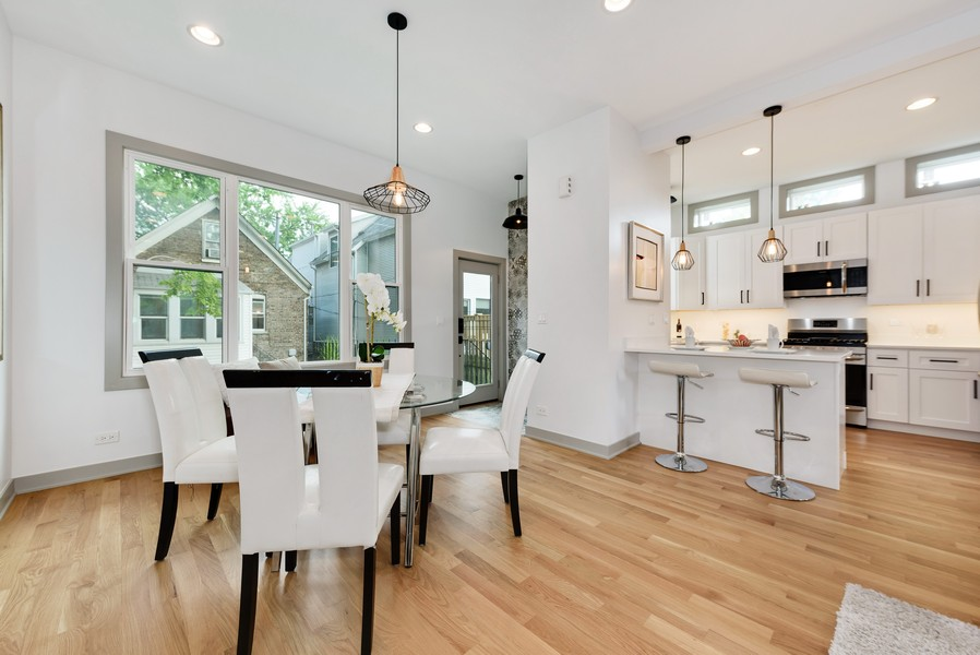 Real Estate Photography - 1847 W Cornelia Ave, Coach house, Chicago, IL, 60657 - Dining Room and Kitchen