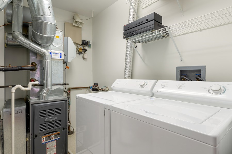 Real Estate Photography - 1445 N Cleveland, Unit A, Chicago, IL, 60610 - Laundry Room