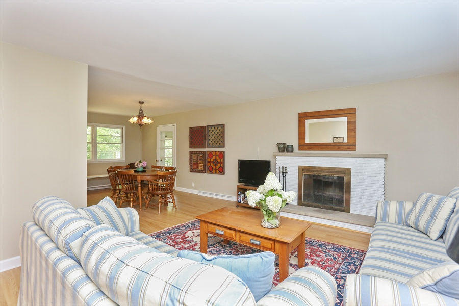 Real Estate Photography - 6713 Parkway Dr, sawyer, MI, 49125 - Living room with wood burning fireplace.