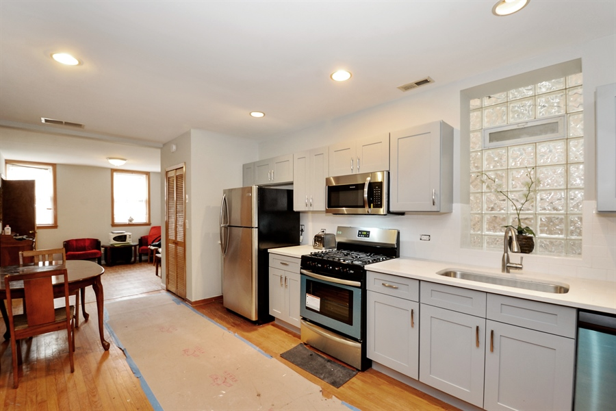 Real Estate Photography - 918 N Mozart, Chicago, IL, 60622 - Unit 1-  Kitchen & Living