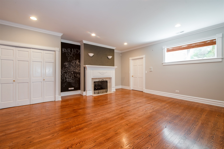 Real Estate Photography - 1735 W. Newport Ave, Chicago, IL, 60657 - Lower Level Family Room