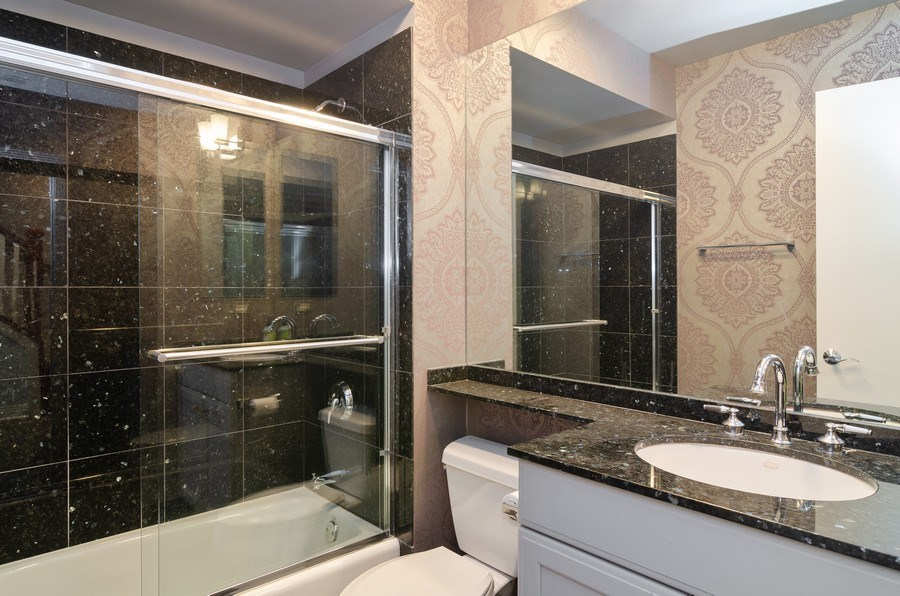 Real Estate Photography - 1816 S Indiana, Unit F, Chicago, IL, 60616 - Bathroom near Family Room