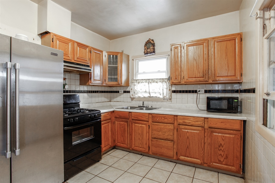 Real Estate Photography - 124 N 17th Ave, Melrose Park, IL, 60160 - Kitchen