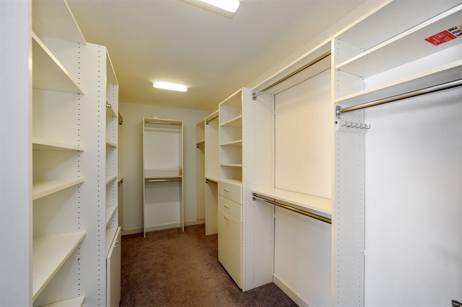 Real Estate Photography - 2100 Thistle Rd, Glenview, IL, 60026 - Master Bedroom Closet