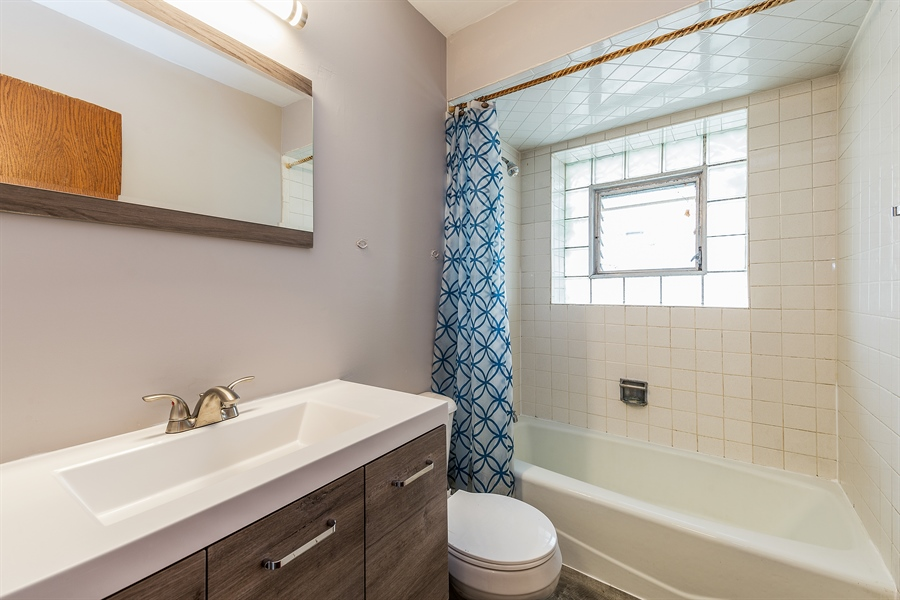 Real Estate Photography - 1660 S Mannheim road, westchester, IL, 60154 - Bathroom