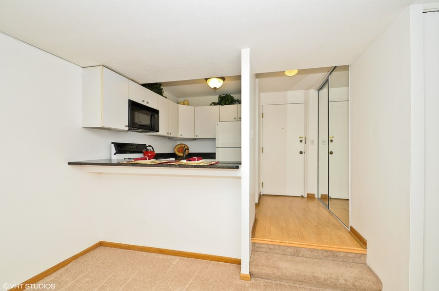 Real Estate Photography - 230 E Ontario St, 1603, Chicago, IL, 60611 - Kitchen and Dining Area