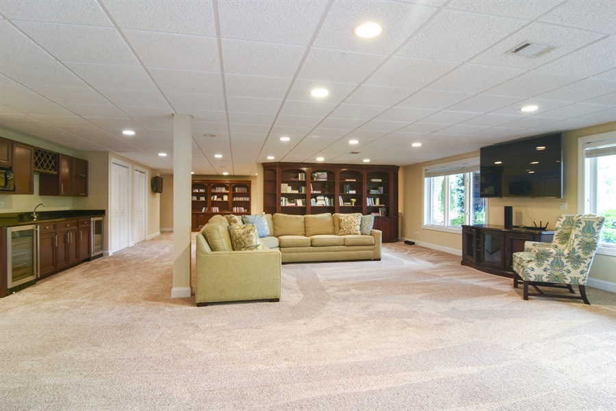 Real Estate Photography - 20817 west high ridge drive, kildeer, IL, 60047 - Lower Level Great Room with Wet Bar