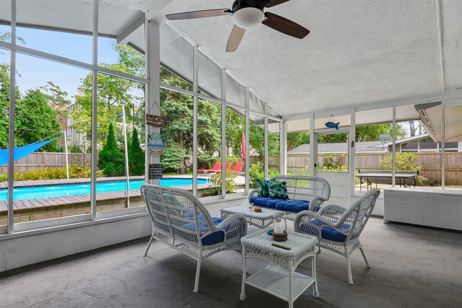 Real Estate Photography - 118 Lockerbie Ln, Wilmette, IL, 60091 - Screened Porch with view of Patio