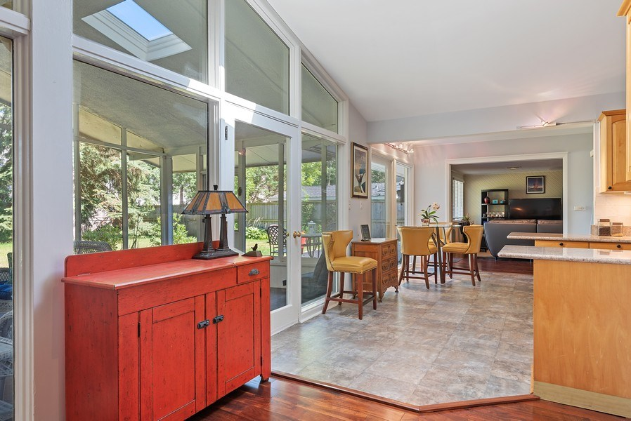 Real Estate Photography - 118 Lockerbie Ln, Wilmette, IL, 60091 - Kitchen leading to screened porch
