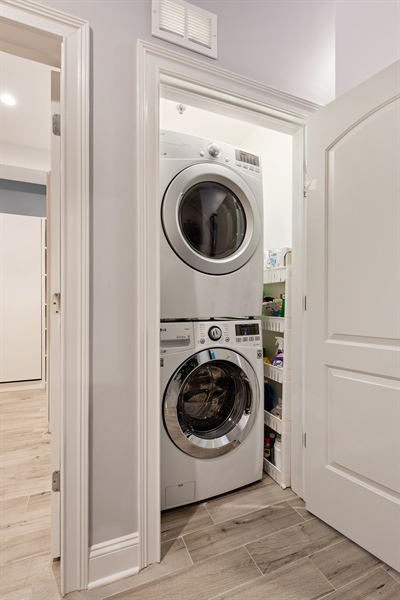 Real Estate Photography - 101 W Superior St, Unit 1203, Chicago, IL, 60654 - Laundry Room