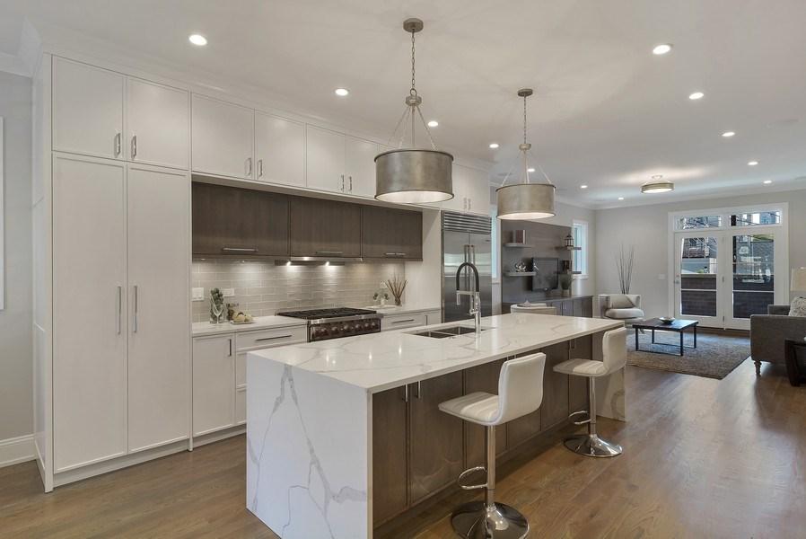 Real Estate Photography - 3913 N Janssen, Unit 1, Chicago, IL, 60613 - Kitchen / Breakfast Room