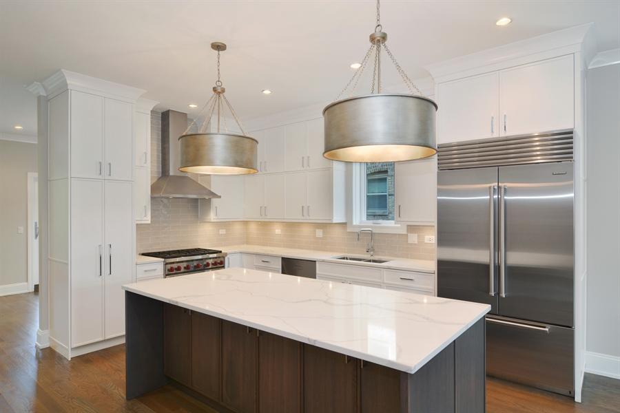 Real Estate Photography - 3913 N Janssen, Unit 2, Chicago, IL, 60613 - Kitchen