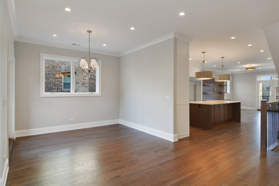 Real Estate Photography - 3913 N Janssen, Unit 2, Chicago, IL, 60613 - Kitchen / Dining Room