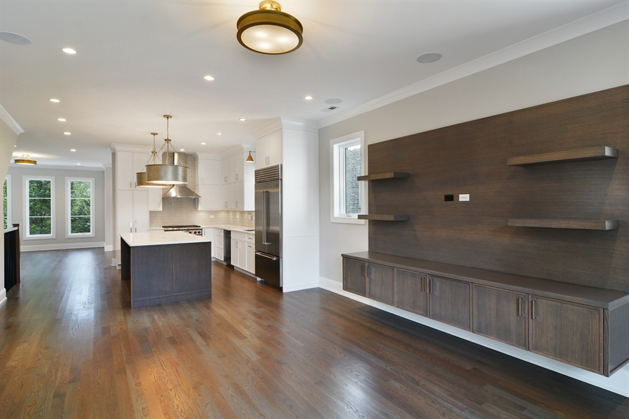 Real Estate Photography - 3913 N Janssen, Unit 2, Chicago, IL, 60613 - Family Room / Kitchen